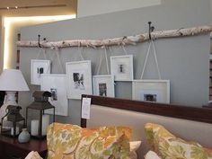 Hanging photo frames from birch branch