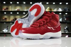 This Air Jordan 11 Gym Red Win Like 96 is a must buy that goes with the holiday season. The sneakers holiday themed design pays homage to MJs greatness and the Chicago Bulls with their 1996 championship season. Bright gym red is used for the updated patent leather mudguard which is cut higher to look like its original samples and mesh/smooth leather accents on the upper. Contrasting black accents are seen on the Jumpman branding, while a white midsole and icy blue translucent outsole Air Jordan Sneakers, Nike Air Jordan 11, Nike Air Max, Sneakers Nike, Black Jordans, Jordans For Men, Discount Jordans, Black Accents, Athletic Shoes