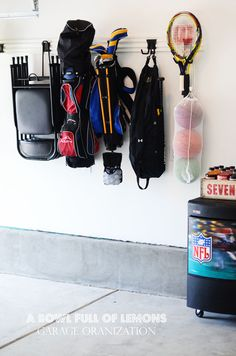 Use Husky heavy duty hooks to organize your sports equipment and other garage clutter! | From A Bowl Full of Lemons