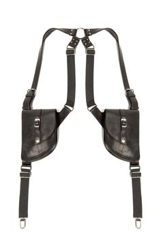 "A brand classic, SKINGRAFT's Suspender Bag is an iconic holster with detachable leather bags, suspender clips, and ""O"" ring harness detail on center back. — Silver nickel hardware — Rugged cow leather"