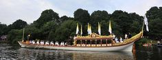 Downstream: The Gloriana was accompanied by its mini flotilla of boats and was given three cheers from those watching on the banks before it set off