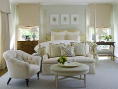 windows flanking the bed are treated to soft Roman Shades, while the larger window wears a valance and drapes.