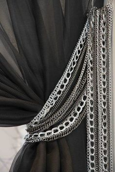 Silver chains as drapery tie backs. Sexy.  Perfect for a Shades of Gray room. Tomas Pearce Interior Design Consulting