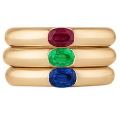 Cartier Ellipse Ruby Emerald Sapphire Gold Stacking Rings | From a unique collection of vintage band rings at https://www.1stdibs.com/jewelry/rings/band-rings/