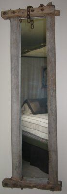 Another perfect fit! A standard wall mirror fit the back of this old cow stanchion from High Farm Primitives (etsy)