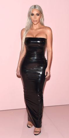 Kim Kardashian West kicked off New York Fashion Week at the Tom Ford fashion show, wearing a skin tight latex maxi dress. Kardashian West went sans jewelry, letting the focus be on the dress (and new hair color).