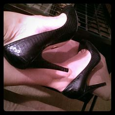 bebe round toe pumps Black snake skin print leather pumps. A very classic style that will not go out of fashion. Fits true to size. Comes in its original box. Please review picture 3 showing the wear on the heel bebe Shoes Heels