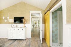 I like the sliding yellow door with the wallpaper to the right.  so pretty.