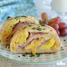 Ham Egg and Cheese Breakfast Rolls Ham Egg and Cheese Breakfast Rolls are a fun new way to serve all the traditional things you love for breakfast! They are perfect on for baby showers Easter brunch Christmas breakfast or for b Breakfast Slider, Make Ahead Breakfast, Breakfast Dishes, Breakfast Time, Breakfast Casserole, Breakfast Recipes, Office Breakfast Ideas, Breakfast Biscuits, Breakfast Sandwiches