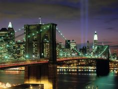 The Broklyn Bridge. I love this picture because in the distance are the eternity beams of light where the World Trade Towers used to stand... <3