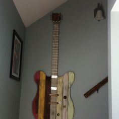Guitar I made from pallet wood; old hinges, pulls, and hooks; and paint left from old house and new house