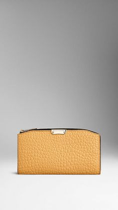 Burberry Saffron Yellow Signature Grain Leather Continental Wallet - A continental wallet in textured signature grain leather.  Folding design with zip and press-stud closure.  Discover more accessories at Burberry.com