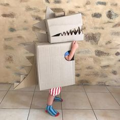 44 Elegant Diy Cardboard Crafts Ideas For Kids Toys To Try Right Now - We spend more time inside during the winter months, and finding interesting things to do can often become a challenge with kids a Diy Dinosaur Costume, Diy Baby Costumes, T Rex Costume, Book Costumes, Kids Costumes Boys, Cardboard Packing Boxes, Big Cardboard Boxes, Cardboard Box Crafts, Cardboard Costume