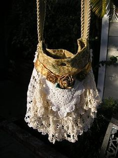 :) What a great idea to do with all those old and partially damaged doilies and linens!