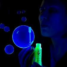 Cut open glow sticks & pour them into bubble solution. Glow in the dark bubbles. Perfect for summer nights !