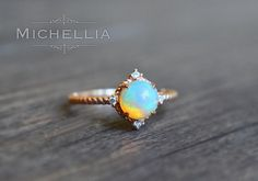 14/18K Opal Aurora Ring, Gold Ethiopian Fire Opal Engagement Ring, Promise Ring, Interstellar Universe Galaxy Ring, Solid Gold Opal Ring by MichelliaDesigns on Etsy https://www.etsy.com/listing/275237440/1418k-opal-aurora-ring-gold-ethiopian