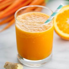 Add a boost to your day with this refreshing and tasty orange carrot ginger smoothie recipe with turmeric! A cool, sweet and tangy healthy beverage.