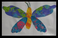 photo of: children's painting butterfly, Eric Carle style, bright paints