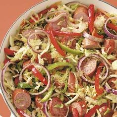 """This colorful medley comes together in no time with sausage and a packaged coleslaw mix. """"It makes a lot and is very filling,"""" writes Shona Germino of Casa Grande, Arizona. """"Plus, it's great for potlucks because it travels so well! Cabbage Recipes, Pork Recipes, Paleo Recipes, New Recipes, Dinner Recipes, Cooking Recipes, Favorite Recipes, Quick Recipes, Delicious Recipes"""