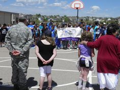 "Students get ready for a ""fight back drill"" May 3, before an American Cancer Society Relay Recess at Stetson Elementary School. ""Platoon members"" stepped out from a military-like formation to recite pledges. They shouted commitments to routine exercise and healthy eating. Kindergarten-fifth grade students spent Spirit Week, April 30-May 4, learning about healthy lifestyles and raising cancer awareness."