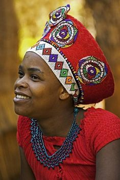 View top-quality stock photos of Zulu Woman In Traditional Red Headdress Of A Married Woman Lesedi Cultural Village Near Johannesburg South Africa. Find premium, high-resolution stock photography at Getty Images. African Tribes, African Women, African Art, African Style, African Dress, We Are The World, People Of The World, Zulu Women, Tribal Women