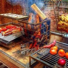 Image may contain: 1 person Outdoor Kitchen Patio, Outdoor Kitchen Design, Fire Cooking, Outdoor Cooking, Barbecue Four A Pizza, Backyard Bbq Pit, Argentine Grill, Bbq Roast, Small Flower Gardens
