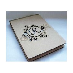 Personalised laser cut and engraved wooden notepad cover.