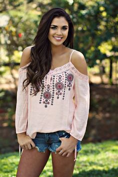 Our Good For The Soul Top is a cold shoulder top with adjustable straps. Embroidery detail to the front along with lace trim. Tie detail to the sleeves. Made to be loose fitted. #southernfriedchics