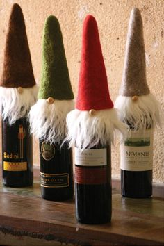 Wispy beard santa wine toppers - Wine toppers make the gift of wine incredibly special, and these charming santas with long, wispy beards will be an instant hit at any holiday party this season! Set of four. One of each color. $39.00