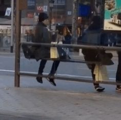 """ Chanbaek waiting at a bus stop in Barcelona. Look at those cute short legs hangin tho. """