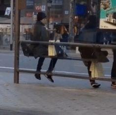 """ Chanbaek waiting at a bus stop in Barcelona. Look at those cute short legs hangin tho. """