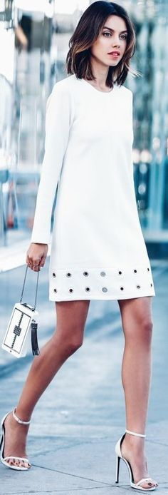 Street style | Stylish white long sleeves mini dress, heels, clutch