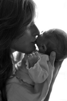 Newborn kisses. Who can hold a new baby and not kiss those faces?