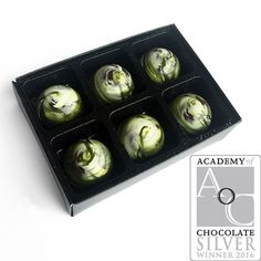 For these Gin & Tonic chocolates we've created a light ganache of smooth white chocolate blended with the multi award winning Williams Chase GB Extra Dry Gin and BTW Tonic.Each chocolate is beautifully hand painted in swirls of green and white, echoing the colours of the gin bottle. They won a SILVER award at the 2016 Academy of Chocolate Awards. #AoCAwards #AcademyofChocolate #Choscars #Williams #Gin (Eponine Patisserie & Chocolaterie)