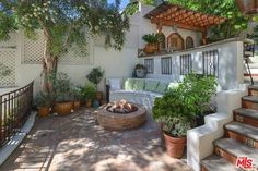 Fire pit area tucked away in a cozy corner. Tyra Banks' Spanish Colonial house in Beverly Hills