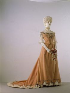 ca. 1900 (Worth) This dress was worn by Princess Nicholas of Greece. Her grandson, the Duke of Kent, gave it to Sir Cecil Beaton, who was then collecting fashionable dress for his 1971 exhibition, Fashion: An Anthology. As with other evening gowns of the period, its original trimmings were very delicate and have been lost. The petticoat and neck edging have been carefully reconstructed from old photographs of Worth designs.