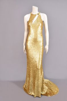 LOT 863  OLEG CASSINI STRETCH SEQUINED GOWN, 1970s.