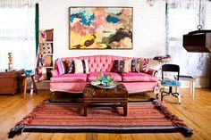 Colorful couch in pink and lovely wall art for the shabby chic living space [Design: Vintage Renewal]