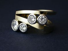 Dynamic Modern Multi-Diamond Ring. The diamonds from old rings were used to create an entirely new, remodeled piece.