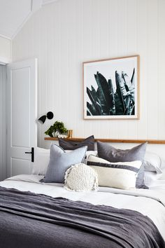 Neutral bedroom | Grey and white tones in this bedroom, with soft textures and white panelled walls
