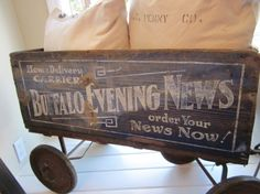 ANTIQUE NEWSPAPER WAGON AT CAMPS AND COTTAGES