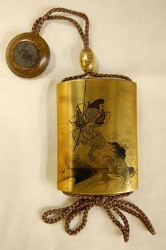 Inro (4 case). Ebisu fishing and Daikoku with mice. Made of lacquered wood (gold).