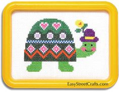 """MIGHTY HANDSOME TURTLE -- 57TR --  Fun to stitch this colorful fellow.  Kit includes 5""""x 7"""" yellow Hoop-Frame, 11-count Aida cloth, and all materials to stitch and frame for all to admire!  EasyStreetCrafts.com"""