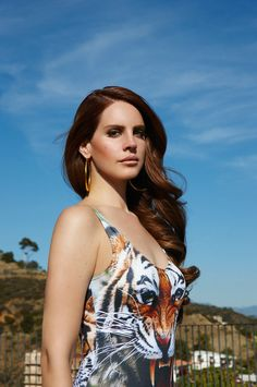 BORN TO LANA reminds me of an early kim basinger shoot wearing tiger one piece