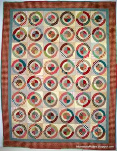 Bulls Eye quilt by Moose Bay Muses. Homespun and plaid fabrics, raw edge circles. From the book Quilts from Aunt Amy