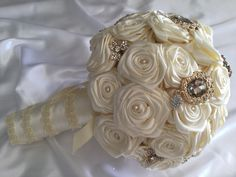 A full sphere of ivory closed roses with a little pearl to form the centre, this is then complimented with some golden brooches both large and small to make a very sophisticated bouquet.  All bouquets can be reproduced in the size and colour of your choice. Feel free to mix and match ideas to make your bouquet more individual. Corsage, MOB and Lapel pins are also available to match your colours. Contact leeann@bejewelledbridal.com.au for more information.