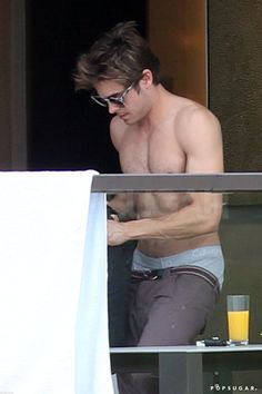 Pin for Later: Today, We Salute Zac Efron's Impeccable Shirtless Body  He was shirtless at his Sydney hotel in April 2012.