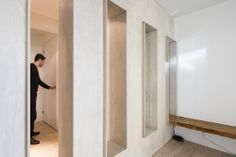 Amsterdam - this project features a perforated separation wall between the livingroom and the entrance hall. The Perforated wall creates a smooth transition between the entrance and livingroom. There are no doors in the complete open floorplan. Two openings are filled with mirrors, behind the mirror the bathtoom is situated. //