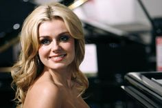 Katherine Jenkins seated at a Harrod's piano. Apparently the department is closing down. I wonder if Ms Jenkins can actually play the piano!