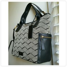 """Fossil Emerson Satchel Gorgeous purse features two top handles and a removable crossbody/shoulder strap. Leather and brass details compliment the grey/black jaquard design. Measurements: height 11"""" - bottom width 12"""" - handle length 15""""- handle drop 5 1/2""""  -Both slip and zippered pockets on each side -Interior zipper compartment with two additonal media pockets.  -Zipper top closure -Signature key embossed luggage tag Offers welcome Fossil Bags Satchels"""